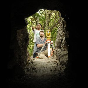 Garrison maps the entrance to a tunnel that leads to the Temple of the Night Sun. Photo by Arturo Godoy, reproduced courtesy of Proyecto Arqueologico El Zotz.