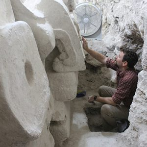 USC Dornsife's Thomas Garrison cleaning a recently uncovered Maya architectural mask at El Zotz, Guatemala. Photo by Sarah Newman, reproduced courtesy of Proyecto Arqueologico El Zotz.