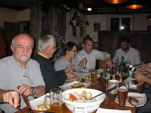 Participants at the 2012 UNIGIS meeting share a meal in Salzburg.